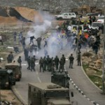 Palestinian, Israeli and foreign protesters run from tear gas fired by Israeli troops during a demonstration on Highway 443 in 2008. (AP)