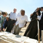The Elders visit the memorial to Bassem Abu Rahmah in Bil'in, 27 August 2009. L-R: Gro Brundtland, Mary Robinson, Fernando Cardoso, Jimmy Carter, Desmond Tutu, Mohammed Khatib, Ela Bhatt, Abdullah Abu Rahma.