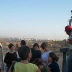 Abdallah with FFIPP students at the site of the Apartheid Wall in Bil'in