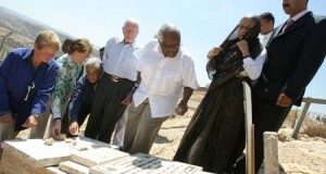 Desmond Tutu (centre) with Abdallah Abu Rahmah of Bil'in popular committe, Ela Bhatt, Jimmy Carter, Fernando H Cardoso, Mary Robinson and Gro Brundtland of the Elders during a visit to Bil'in