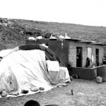 A home that faces demolition, with a tent already put in place beside it. Whenever Israeli soldiers enter the village, the family that owns the house removes all of their belongings from it and places them in the tent, accepting the fact that they may lose their home, but can still survive as long as they retain their property.
