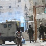 Palestinian escapes from tear gas