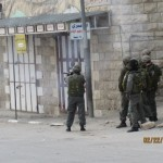 Israeli soldier fires tear gas in Yatta Road