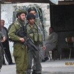 Israeli soldier with tear gas gun in Yatta Road