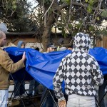 Israelis, internationals and Palestinians rebuild Gawi living space outside their occupied house.