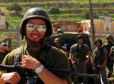 Israeli Occupation Force soldier daydreams about quitting time in Al-Ma'sara.