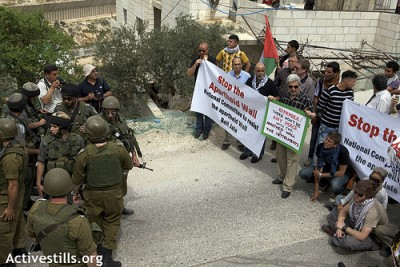 Soldiers, armed to the teeth, meet non-violent protesters in Beit Jala.