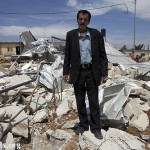 Ali Salim Mousa stands in the middle of the rubble of his house, demolished on 14.04.2010, in Al Khader.