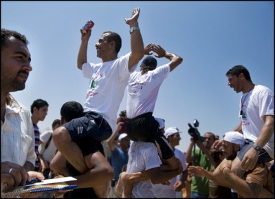 The winner of the boat race, Jamal Baker, is lifted aloft by friends and supporters
