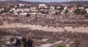 Soldiers in front of illegal settlement in Qusin
