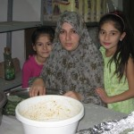 Abdallah's wife Majida and daughters Louma (8) and Layam (8) during preparations for Eid.