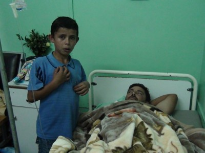 Ibrahim Yousef Ghaben, 28, with leg fractures