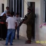 Soldiers enter At-Tuwani