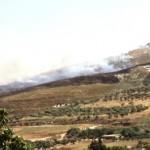 Settlers set Burin farmland ablaze.