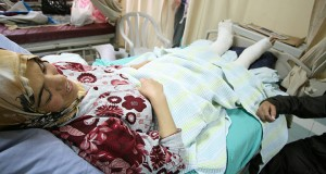 Muhaya Khatatba resting following injuries sustained as she fled from violent settlers