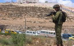 "Soldiers set up a ""flying checkpoint"" outside Ramallah, near the village of Surda"