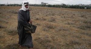 Mahmood Suleiman Qudiah sows wheat near the Buffer Zone (Photo: Radhika Sainath, Notes from Behind the Blockade) - Click here for more images