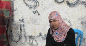 Hibba al-Najjar (17) sitting opposite her home in Khuza'a village (Photo: Palestinian Centre for Human Rights)