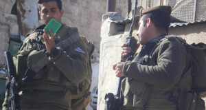 Israei military checking IDs along Shuhada Street