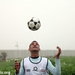 "A Palestinian plays football in the no go zone near Erez during the weekly demonstration against the occupation in Beit Hanoun, Gaza Strip, Tuesday, February 7, 2012. Every Tuesday Palestinians and supporters march from Beit Hanoun into the ""buffer zone"" or ""no go"" zone , where the fertile land has been made inaccessible to Palestinians due to the imminent danger of shooting  by the Israeli army."