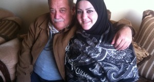 Amani al Khandaqja with her father, pose following her release