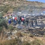 Israeli soldiers prevent Palestinians from putting out the fires started by Israeli settlers further up the hill - click here for more photos