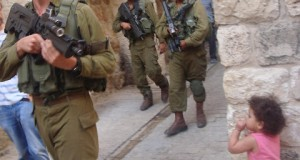 Soldiers move through the old city of Hebron