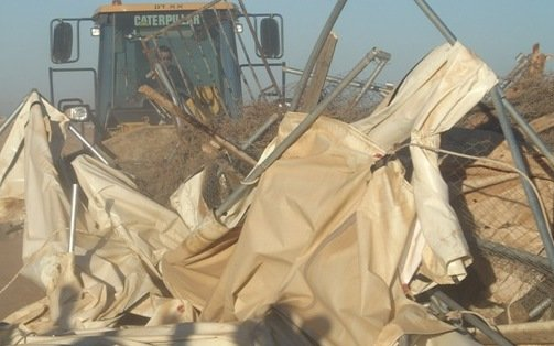 Caterpillar Bulldozer demolishing tents donated to the residents of Susiya as emergency aid by the U.N.