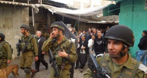 Soldiers and Zionist tourists invade the Palestinian souq