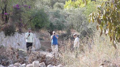 Settlers film and take photos at Khan al-Luban Friday