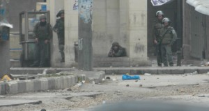 Snipers taking up prone positions on the streets in Hebron