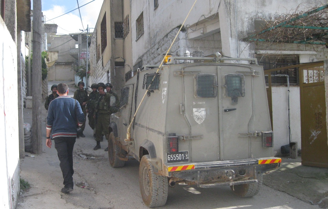 Soldiers checking people in the streets of Urif