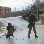 Soldiers protecting settlers while destroying trees in Urif