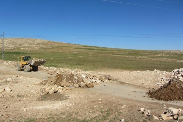 Bulldozer blocking the entrance to At Tuwani village