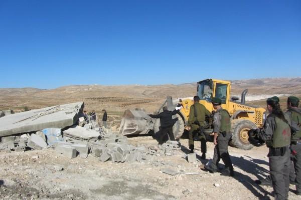 Volvo bulldozer demolishing cistern in Huwara village