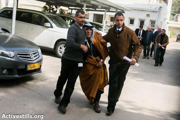 Arafat's father after identifying his son's tortured body (Photo: Yotam Ronen/Activestills.org)