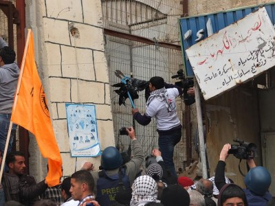 Demonstrator tries to open fence blocking access to Shuhada street