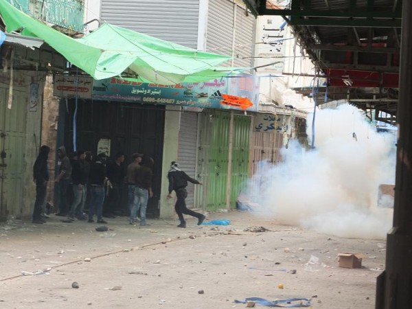 Tear gas is launched at demonstrators