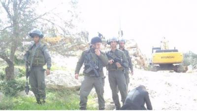 Soldiers around the demolition site