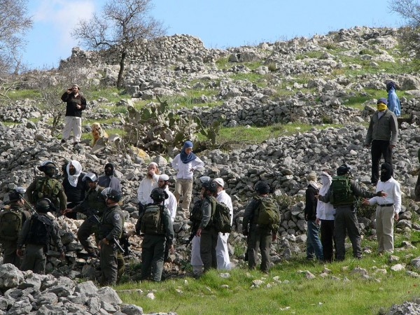 Army trying to keep the settlers at bay in the beginning. (Photo Katie W., ISM)