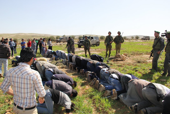 Residents of Canaan praying at the camp site (Photo: Beit Ommar Popular Movement)