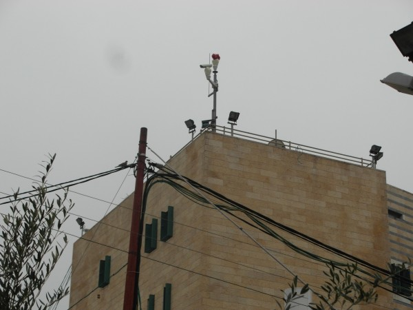 Cameras and lights installed above the home by the military