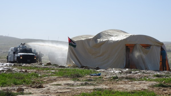 Canaan tent being skunk watered (Photo: ISM)