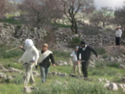 Settler with a slingshot at Al-Manatir (Photo: ISM)