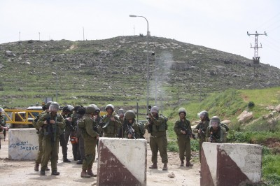 Soldiers fire tear gas at demonstrators