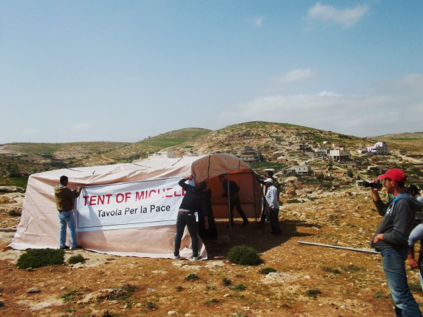 Tent being assembled by activists on the oustkirts of At-Tuwani