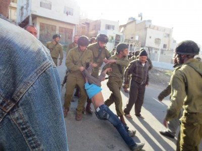 Schoolchild being dragged by Israeli military