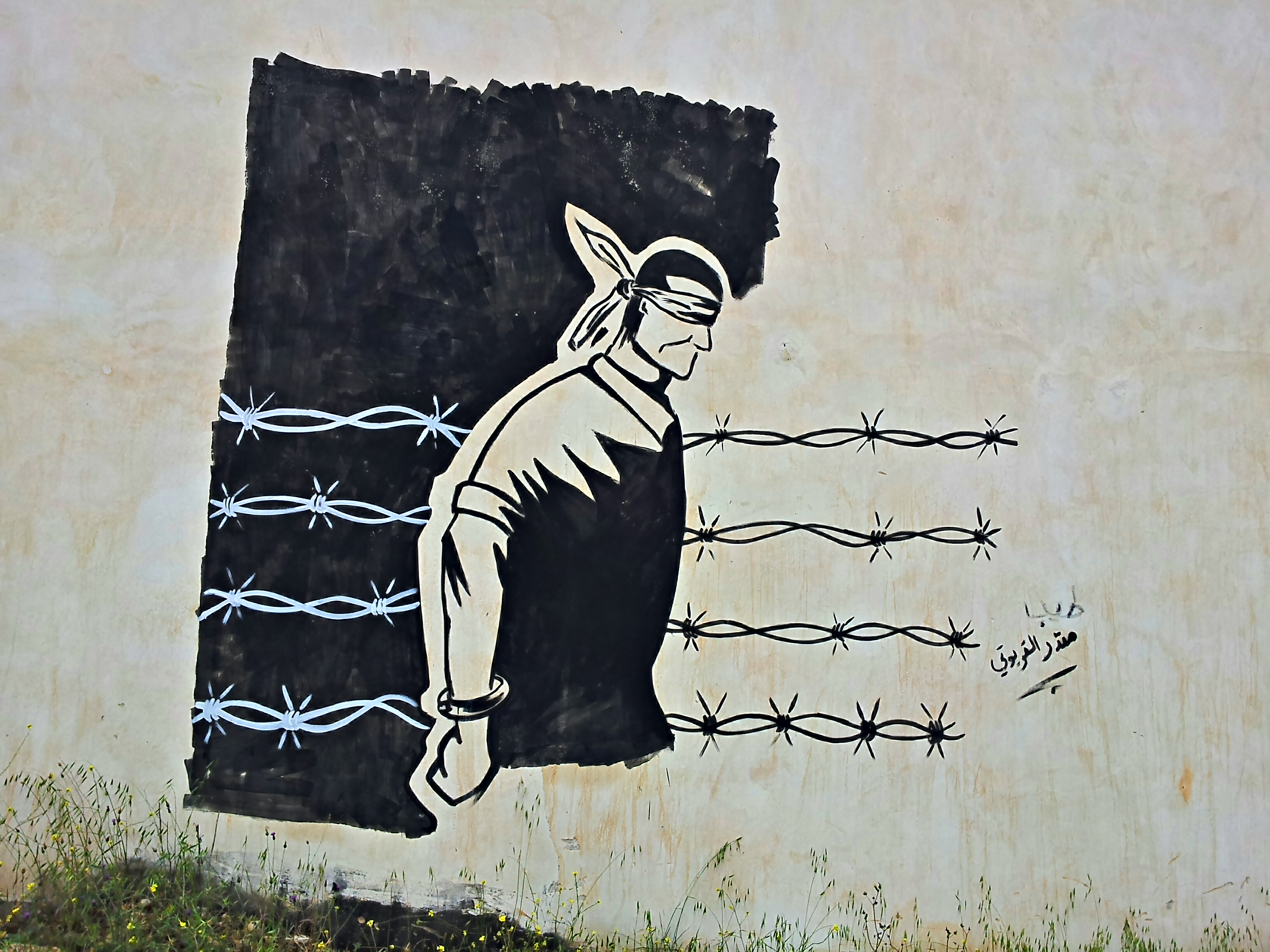 A painting in honour of the fifteen detainees in Qaryut (Photo by ISM)