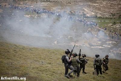 Israeli military shooting tear gas at protesters. Photo credit: Activestills
