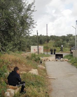 Nabi Saleh boy watching Israeli soldiers invading his village